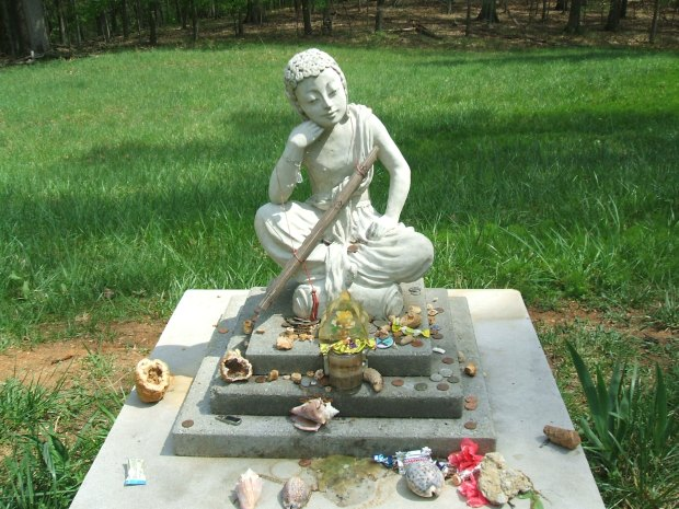 Buddha figure with offerings