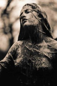 Statue at Montmartre Cemetery, Paris France. Photographer unknown